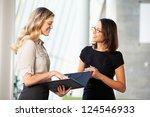 Two Businesswomen Having...