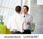 two businessmen having informal ... | Shutterstock . vector #124546987
