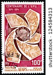 Small photo of AFARS AND ISSAS - CIRCA 1974: a stamp printed in Afars and Issas shows Letters Around UPU Emblem, Centenary of Universal Postal Union, circa 1974