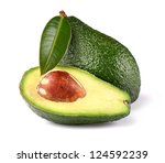 Ripe avocado with leaf - stock photo