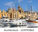 The big harbor of the city Valetta, Malta with modern yachts laying before ancient buildings - stock photo