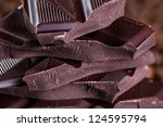Fresh roasted coffee beans and stack of brown chocolate - stock photo