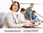 senior business woman working... | Shutterstock . vector #124625947