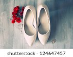 photo of white shoes and flowers | Shutterstock . vector #124647457