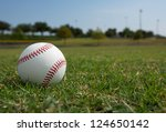 New Baseball in the Outfield - stock photo