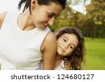 portrait mom and daughter at... | Shutterstock . vector #124680127