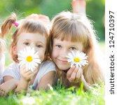 happy children with flowers... | Shutterstock . vector #124710397