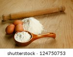 Homemade italian fresh pasta ingredients: flour and eggs - stock photo