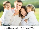 happy family playing outdoors... | Shutterstock . vector #124768267