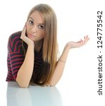 The thoughtful young girl looking at camera on white background. - stock photo