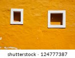 old yellow wall and window in... | Shutterstock . vector #124777387
