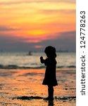 Child On Sunset Beach