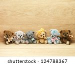 Teddy Bears On Wooden Background