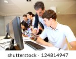 adult man helping student in... | Shutterstock . vector #124814947