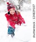 girl makes a snowman outside in ... | Shutterstock . vector #124829107
