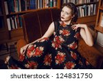 Beautiful fashionable student sitting in the university library - stock photo