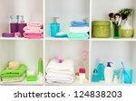bath accessories on shelfs in... | Shutterstock . vector #124838203