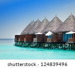 houses on piles on water - stock photo