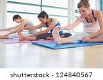 Women Stretching In Yoga Class...