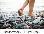 Young Woman On The Beach...