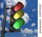 Traffic Light in a blue sky with all the lights on. - stock photo