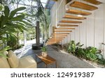 Beautiful cantilevered stairway in an atrium, residential structure - stock photo