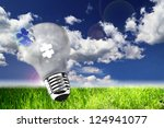 Small photo of utopic nature and lightbulb, concept of ecology