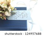 hand writing message card with bouquet and gift for Father's day image - stock photo