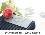 thank you card with blue gift box and flower bouquet - stock photo