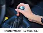 hand on manual gear shift knob | Shutterstock . vector #125000537