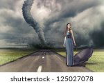woman,with umbrella on the road and tornado - stock photo