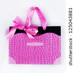 Beauty pink paper bag with ribbon - stock photo