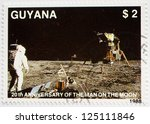 GUYANA - CIRCA 1988: a stamp from Guyana shows image of the first moon landing, circa 1988 - stock photo
