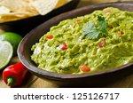 guacamole with avocado  lime ... | Shutterstock . vector #125126717