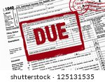 red stamp on income tax form - stock photo