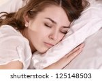 beautiful girl lying in bed at... | Shutterstock . vector #125148503