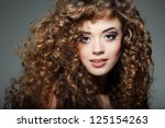 young beautiful woman with long ... | Shutterstock . vector #125154263