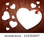 paper hearts on a wooden... | Shutterstock .eps vector #125203697