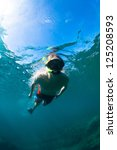 young man free diving and... | Shutterstock . vector #125208593
