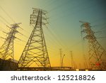 Power transmission towers of sky background - stock photo