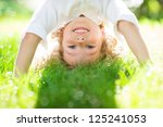 happy child playing outdoors in ... | Shutterstock . vector #125241053