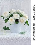 White roses in a ceramic vase. - stock photo