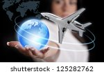 Girl with the planet Earth and the airliner. - stock photo