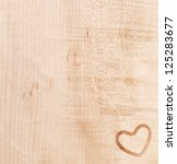 a heart silhouette on wooden desk - stock photo