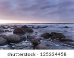 Beautiful ocean scene, last sunlight of a summers day - stock photo