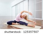 young woman doing stretching | Shutterstock . vector #125357507