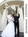 Newlyweds Release Pigeons At...