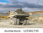 opencast mine excavator and railway - stock photo