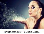 beautiful girl blowing magic... | Shutterstock . vector #125562383
