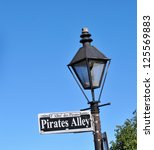 Pirates Alley Street Sign In New Orleans, Louisiana, French Quarter - stock photo